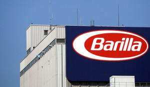 A logo sits on the wall of the Barilla Holding SpA pasta factory in Parma, Italy, on Wednesday, Oct. 3, 2012. Barilla Holding SpA is the world's biggest pasta manufacturer. Photographer: Alessia Pierdomenico/Bloomberg via Getty Images